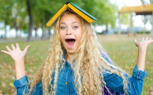 Humorous portrait of girl students in the park